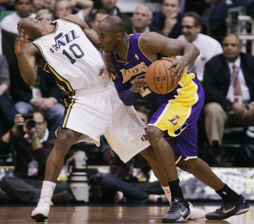 Kim Raff | The Salt Lake Tribune (left) Utah Jazz point guard Alec Burks (10) reacts to getting a shoulder in the face by (right) Los Angeles Lakers shooting guard Kobe Bryant (24) during a game at EnergySolutions Arena in Salt Lake City, Utah on November 7, 2012.