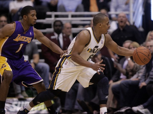 Kim Raff | The Salt Lake Tribune (right) Utah Jazz point guard Randy Foye (8) tries to keep possession of the ball from (left) Los Angeles Lakers point guard Darius Morris (1) during a game at EnergySolutions Arena in Salt Lake City, Utah on November 7, 2012.