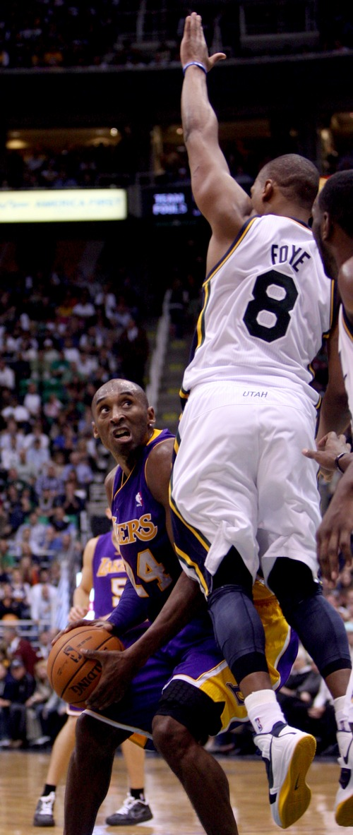 Kim Raff | The Salt Lake Tribune (left) Los Angeles Lakers shooting guard Kobe Bryant (24) looks to for an opening as Utah Jazz point guard Randy Foye (8) defends during a game at EnergySolutions Arena in Salt Lake City, Utah on November 7, 2012. Jazz went on to win the game 95-86.