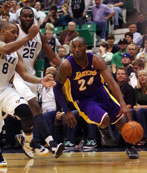 Kim Raff | The Salt Lake Tribune (right) Los Angeles Lakers shooting guard Kobe Bryant (24) drives the basket past (left) Utah Jazz point guard Randy Foye (8) and (middle) Utah Jazz center Al Jefferson (25) during a game at EnergySolutions Arena in Salt Lake City, Utah on November 7, 2012.