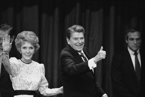 Nancy and Ronald Reagan signal to well-wishers and supporters at the Century Plaza Hotel at night, Tuesday, Nov. 7, 1984 in Los Angeles after Reagan was declared the winner in the 1984 presidential election against Democratic opponent Walter Mondale. (AP Photo)