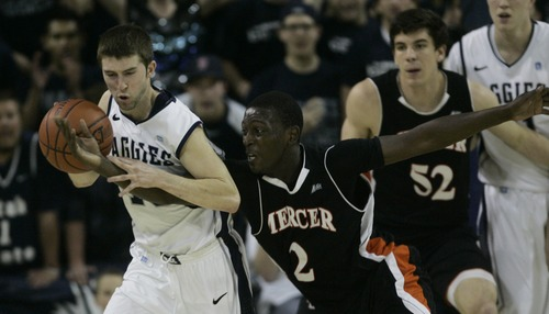 Kim Raff   The Salt Lake Tribune Utah State University Preston Medlin tries to hang onto the ball as Mercer player Travis Smith reaches for it during the CIT Championship game at Utah State University in Logan, Utah on March 28, 2012.  Mercer went on to win the game 67-70.