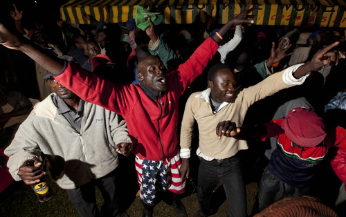 Villagers dance at an all-night party to watch the U.S. presidential election in the village of Kogelo, home to Sarah Obama the step-grandmother of President Barack Obama, in western Kenya Tuesday, Nov. 6, 2012. (AP Photo/Ben Curtis)