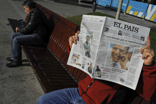 A man reads a Spanish newspaper with the smiling portrait of U.S. President Barack Obama on his front page, in Pamplona northern Spain, Wednesday, Nov. 7, 2012. It is announced early Wednesday that Obama has been re-elected to be U.S. President for next four years. (AP Photo/Alvaro Barrientos)