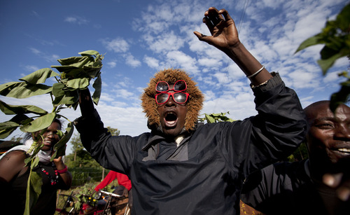 Villagers cheer and wave branches to celebrate Obama's re-election in the village of Kogelo, home to Sarah Obama, the step-grandmother of President Barack Obama, in western Kenya Wednesday, Nov. 7, 2012. (AP Photo/Ben Curtis)
