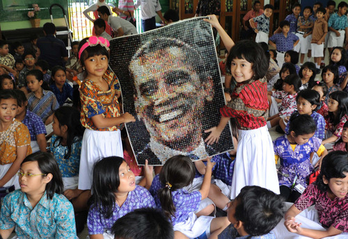 Students hold a poster of U.S. President Barack Obama as they watch the US election vote counting at SDN 01 Menteng elementary school where Obama studied in Jakarta, Indonesia, Wednesday, Nov. 7, 2012. Obama attended the school when he was a child while living in the Southeast Asian nation. (AP Photo)