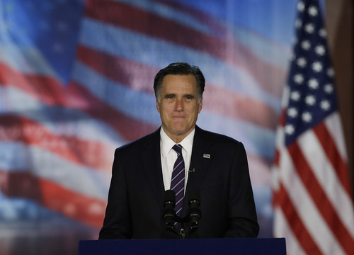 Republican presidential candidate and former Massachusetts Gov. Mitt Romney arrives to his election night rally, Wednesday, Nov. 7, 2012, in Boston. President Obama defeated Republican challenger former Massachusetts Gov. Mitt Romney. (AP Photo/David Goldman)
