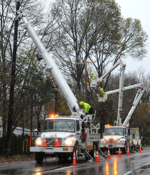 A National Grid crew from Fredonia, N.Y. , repair power lines on Port Washington Blvd. that were brought down from the effects of Superstorm Sandy on Wednesday, Nov. 7, 2012, in Port Washington, N.Y. (AP Photo/Kathy Kmonicek)