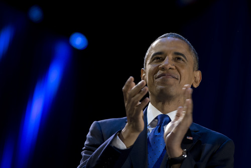 President Barack Obama pauses as he speaks at the looks the the cheering crowd at the election night party at McCormick Place, Wednesday, Nov. 7, 2012, in Chicago. Obama defeated Republican challenger former Massachusetts Gov. Mitt Romney. (AP Photo/Carolyn Kaster)