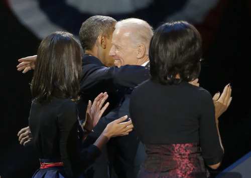President Barack Obama hugs Vice President Joe Biden after his speech at his election night party Wednesday, Nov. 7, 2012, in Chicago. President Obama defeated Republican challenger former Massachusetts Gov. Mitt Romney. (AP Photo/Pablo Martinez Monsivais)