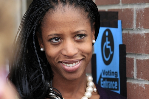 Republican congressional candidate Mia Love stands in line with others to vote Thursday, Nov. 1, 2012, in Saratoga Springs, Utah. Six-term Democrat Jim Matheson and Love, the Republican mayor of Saratoga Springs,  are squaring off in what has been Utah's most hotly contested congressional race this year.  Polls show incumbent Matheson is in a dead heat with Mia Love in the newly redrawn 4th District. The race has been Utah's most expensive General Election campaign, with candidates and outside groups funding a $6 million advertising war.   (AP Photo/Rick Bowmer)