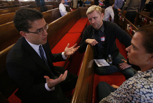 Scott Sommerdorf  |  The Salt Lake Tribune               Josh Weed speaks with Troy Williams, center, and Sarah Colombo after he spoke at the Circle the Wagons' second annual conference held at the Wasatch Presbyterian Church in Salt Lake City, Saturday, November 3, 2012.