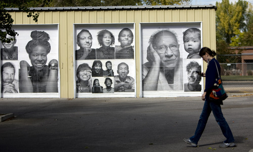 Kim Raff | The Salt Lake Tribune Inside Out Project exhibit's portraits of people in the Neighborhood House community as part of the Urban Art Gallery on its property in Salt Lake City.