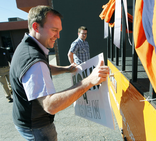 Al Hartmann | The Salt Lake Tribune Newly elected Salt Lake County Mayor Ben McAdams, left, begins to tear down posters on his campaign bus at his Salt Lake City headquarters with campaign manager Justin Miller Wednesday November 7.