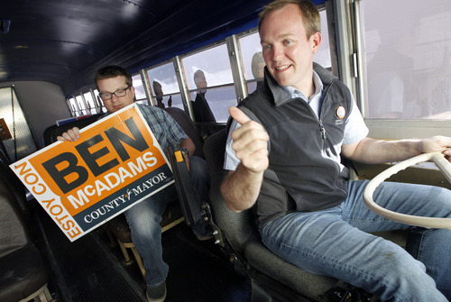 Al Hartmann | The Salt Lake Tribune Newly elected Salt Lake County Mayor Ben McAdams, right, drives his orange campaign bus off the parking lot at his campaign headquarters as he begins to shut down his Salt Lake City office with campaign manager Justin Miller Wednesday November 7.