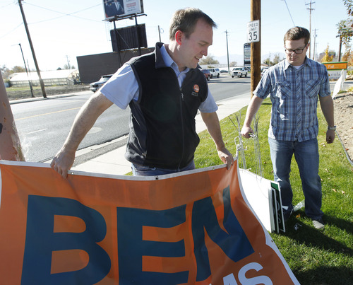 Al Hartmann | The Salt Lake Tribune Newly elected Salt Lake County Mayor Ben McAdams, left, and  campaign manager Justin Miller take down political banners and signs from his campaign headquarters in Salt Lake City  Wednesday November 7.