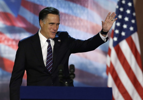 Republican presidential candidate and former Massachusetts Gov. Mitt Romney waves to supporters before conceding at his election night rally, Wednesday, Nov. 7, 2012, in Boston. (AP Photo/Elise Amendola)