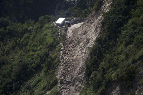 An overhead view of a road damaged when a magnitude 7.4 earthquake struck in San Marcos, Guatemala, Wednesday, Nov. 7, 2012. The mountain village, some 80 miles (130 kilometers) from the epicenter, suffered much of the damage with some 30 homes collapsing in its center. There are three confirmed dead and many missing after the strongest earthquake to hit Guatemala since a deadly 1976 quake that killed 23,000. (AP Photo/Moises Castillo)