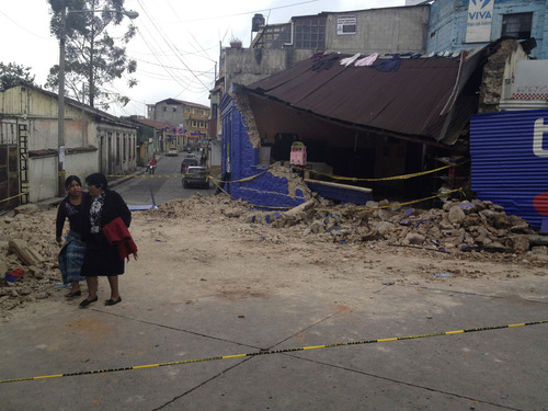 Two women walk past a building damaged after a magnitude 7.4 earthquake struck in San Marcos, Guatemala, Wednesday Nov. 7, 2012. The mountain village, some 80 miles (130 kilometers) from the epicenter, suffered much of the damage with some 30 homes collapsing in its center. There are three confirmed dead and many missing after the strongest earthquake to hit Guatemala since a deadly 1976 quake that killed 23,000. (AP Photo/Moises Castillo)