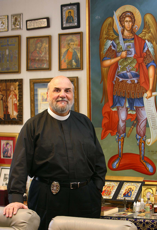 Holladay - Wearing a badge and a collar, Father Michael Kouremetis of the Prophet Elija Greek Orthodox Church also works as a police chaplain for the Midvale Police Department. The Salt Lake Tribune/Trent Nelson; 2.08.2007