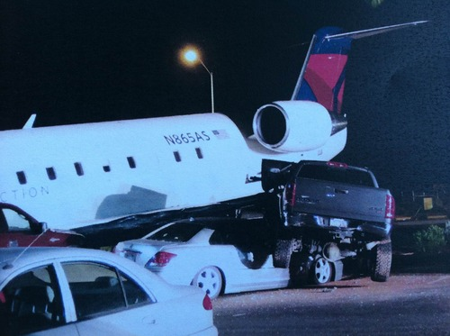 A Canadair Regional Jet 200 sits ontop of cars on July 17, 2012, at the airport in St. George. Brian Hedglin, 40, attempted to steal the airplane but committed suicide after he instead crashed it. Hedglin was suspected of murdering his estranged girlfriend in Colorado. Photo courtesy the city of St. George.