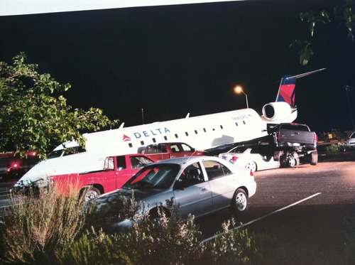 A Canadair Regional Jet 200 sits ontop of cars on July 17, 2012, at the airport in St. George. Brian Hedglin, 40, attempted to steal the airplane. Hedglin was a pilot for SkyWest airlines. Photo courtesy the city of St. George.