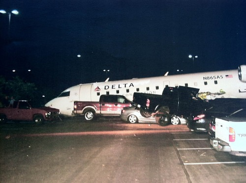 A Canadair Regional Jet 200 sits ontop of cars and with its nose in the pavement on July 17, 2012, at the airport in St. George. Brian Hedglin, 40, attempted to steal the airplane but committed suicide after he instead crashed it. Hedglin was suspected of murdering his estranged girlfriend in Colorado. Photo courtesy the city of St. George.