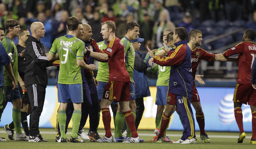 Real Salt Lake and Seattle Sounders players exchange words and a few shoves as they leave the field following the second half of a MLS Western Conference semifinal soccer match, Friday, Nov. 2, 2012, in Seattle. The match, the first of a two-match aggregate game, finished with a score of 0-0. (AP Photo/Ted S. Warren)
