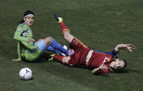 Seattle Sounders forward Fredy Montero (17) and Real Salt Lake midfielder Fredy Montero(8) go after a ball in the first half during an MLS Western Conference semifinal soccer match Thursday, Nov. 8, 2012, in Sandy, Utah. (AP Photo/Rick Bowmer)