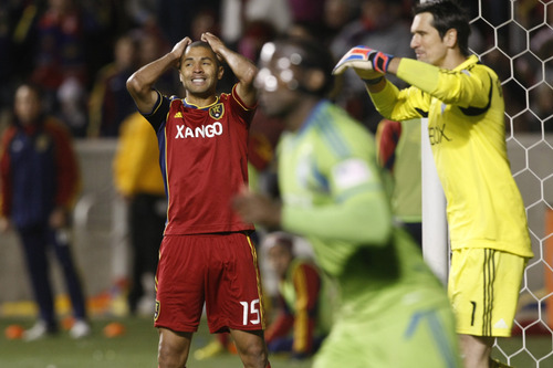 Chris Detrick  |  The Salt Lake Tribune Real Salt Lake forward Alvaro Saborio (15) reacts after missing a shot on goal during the second half of the Major League Soccer playoff game at Rio Tinto Stadium Thursday November 8, 2012. Seattle won the game 1-0. Seattle Sounders FC goalkeeper Michael Gspurning (1) and Seattle Sounders FC defender Jhon Kennedy Hurtado (34) are at right.