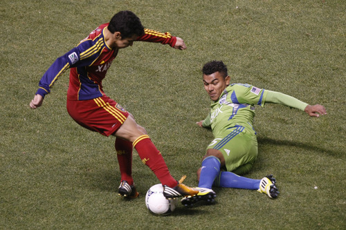 Chris Detrick  |  The Salt Lake Tribune Real Salt Lake defender Tony Beltran (2) and Seattle Sounders FC midfielder Mario Martinez (15) go for the ball during the first half of the Major League Soccer playoff game at Rio Tinto Stadium Thursday November 8, 2012. The score is 0-0 at halftime.
