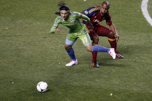 Chris Detrick  |  The Salt Lake Tribune Real Salt Lake defender Jamison Olave (4) and Seattle Sounders FC forward Fredy Montero (17) during the first half of the Major League Soccer playoff game at Rio Tinto Stadium Thursday November 8, 2012. The score is 0-0 at halftime.