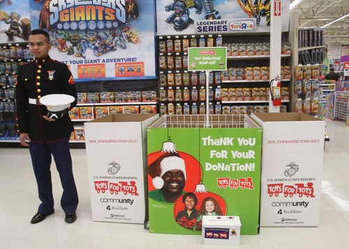 Rick Egan  | The Salt Lake Tribune  U.S. Marine Lance Cpl. Marc Sumampong stands ready to assists shoppers interested in donating to Toys for Tots at the Murray Toys R Us store. Local Marine units will be helped kick off the annual holiday toy drive to benefit the Marine Toys for Tots Foundation.