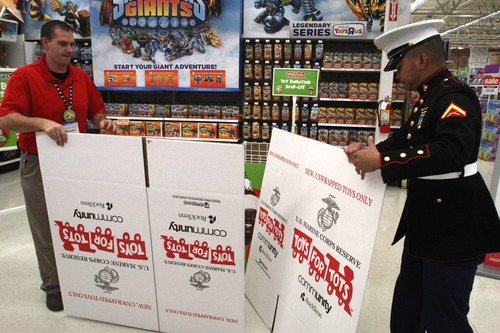 Rick Egan  | The Salt Lake Tribune  Toys R Us store manager James Cook and U.S. Marine Lance Cpl. Marc Sumampong set up boxes for Toys for Tots at the Murray store. Local Marine units heledp kick off the annual holiday toy drive to benefit the Marine Toys for Tots Foundation.
