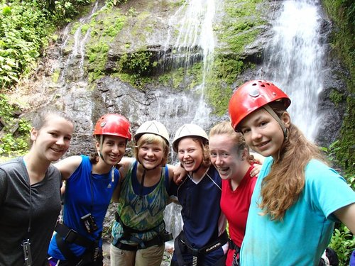 Shaniah Hall, second from the left, with a group of Girl Scouts on a Costa Rica Outward Bound adventure. She and her friends had to repel down this 60-foot waterfall in Costa Rica after hiking for nearly 40 miles on a multiple-day trek. Courtesy photo