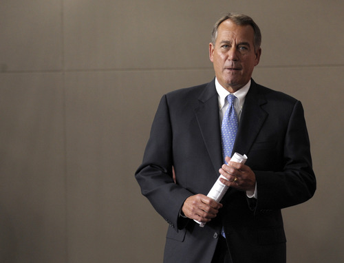 House Speaker John Boehner of Ohio arrives for a news conference on Capitol Hill in Washington, Friday, Nov. 9, 2012. Boehner said any deal to avert the so-called fiscal cliff should include lower tax rates, eliminating special interest loopholes and revising the tax code.  (AP Photo/Susan Walsh)