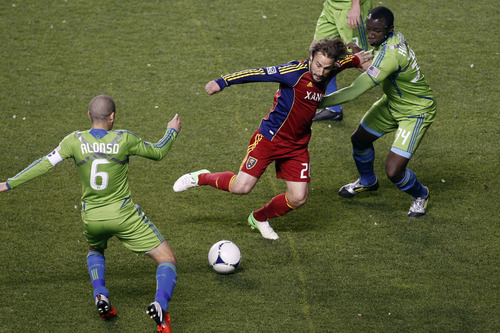 Real Salt Lake midfielder Ned Grabavoy (20) Seattle Sounders FC midfielder Osvaldo Alonso (6) and Seattle Sounders FC defender Jhon Kennedy Hurtado (34) during the first half of an MLS playoff game  at Rio Tinto Stadium in Sandy, Utah, Thursday Nov. 8, 2012.  (AP Photo/The Salt Lake Tribune, Chris Detrick)