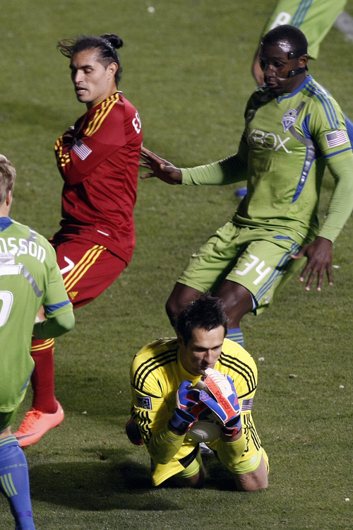 Seattle Sounders FC goalkeeper Michael Gspurning (1) makes a save against Real Salt Lake forward Fabian Espindola (7) during the second half of the Major League Soccer playoff game at Rio Tinto Stadium Thursday Nov. 8, 2012. Seattle won the game 1-0. (AP Photo/The Salt Lake Tribune, Chris Detrick)
