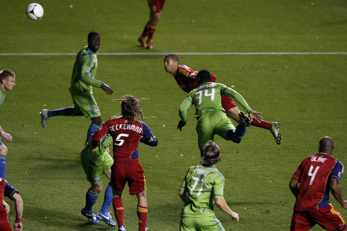 Real Salt Lake forward Alvaro Saborio (15) attempts a header goal past Seattle Sounders FC defender Jhon Kennedy Hurtado (34) during the second half of the Major League Soccer playoff game at Rio Tinto Stadium Thursday Nov. 8, 2012. Seattle won the game 1-0. (AP Photo/The Salt Lake Tribune, Chris Detrick)
