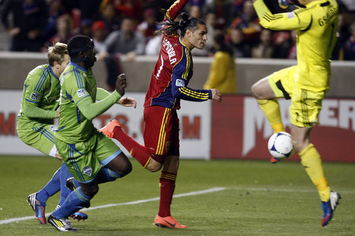 Seattle Sounders FC goalkeeper Michael Gspurning (1) makes a save against Real Salt Lake forward Fabian Espindola (7) during the second half of the Major League Soccer playoff game at Rio Tinto Stadium Thursday November 8, 2012. Seattle won the game 1-0. (AP Photo/The Salt Lake Tribune, Chris Detrick)