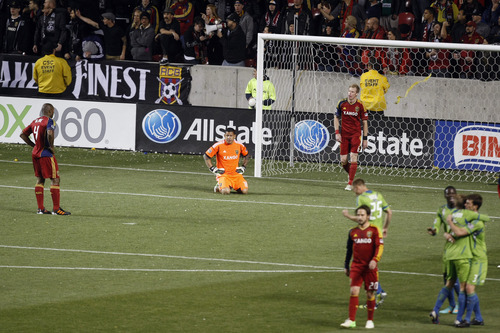 Real Salt Lake goalkeeper Nick Rimando (18) remains on the ground after Seattle Sounders FC midfielder Mario Martinez (15) scored a goal during the second half of the Major League Soccer playoff game at Rio Tinto Stadium Thursday November 8, 2012. Seattle won the game 1-0. (AP Photo/The Salt Lake Tribune, Chris Detrick)