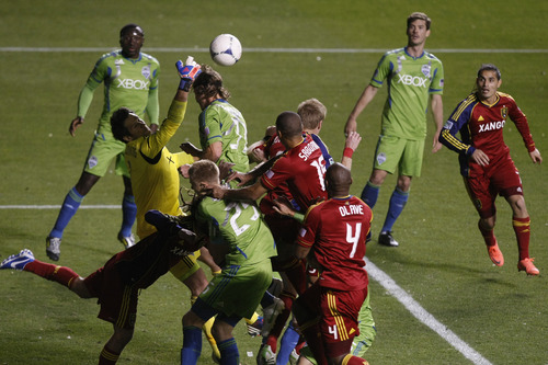 Seattle Sounders FC goalkeeper Michael Gspurning (1) makes a save during the second half of the Major League Soccer playoff game at Rio Tinto Stadium Thursday  Nov. 8, 2012. (AP Photo/The Salt Lake Tribune, Chris Detrick)