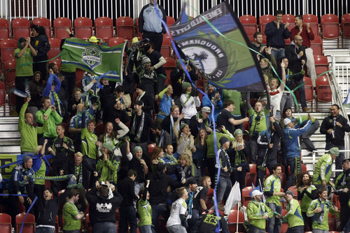 Seattle fans cheer during the second half of the Major League Soccer playoff game at Rio Tinto Stadium Thursday  Nov. 8, 2012. (AP Photo/The Salt Lake Tribune, Chris Detrick)