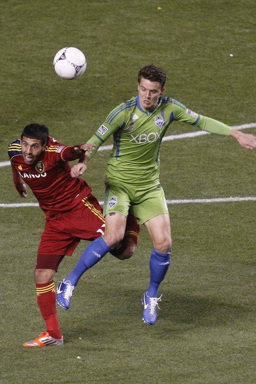 Real Salt Lake midfielder Javier Morales (11) and Seattle Sounders FC defender Marc Burch (8) go for the ball during the first half of the Major League Soccer playoff game at Rio Tinto Stadium Thursday Nov. 8, 2012. (AP Photo/The Salt Lake Tribune, Chris Detrick)