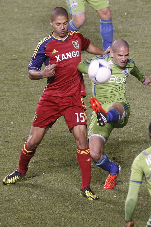 Real Salt Lake forward Alvaro Saboru (15) and Seattle Sounders FC midfielder Osvaldo Alonso (6) go for the ball during the first half of the Major League Soccer playoff game at Rio Tinto Stadium Thursday  Nov. 8, 2012. (AP Photo/The Salt Lake Tribune, Chris Detrick)