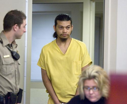 Paul Fraughton  |  The Salt Lake Tribune Esar Met enters the courtroom during his preliminary hearing on Friday. Met is accused of killing 7-year-old Hser Ner Moo in 2008.