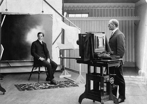 (Photo Courtesy Utah State Historical Society)  Salt Lake photographer Robert Frees in his studio, circa 1900.