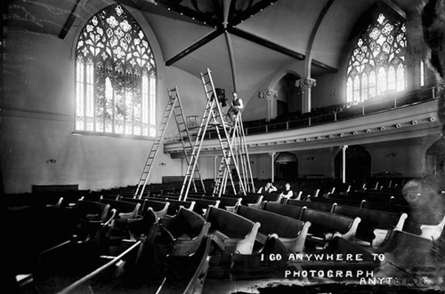 (Photo Courtesy Utah State Historical Society)  Salt Lake photographer Harry Shipler on a ladder, photographing the interior of the First Presbyterian Church in 1906.