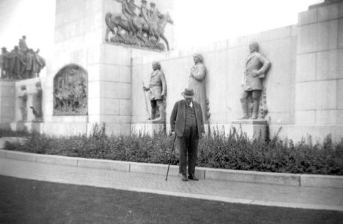 (Photo Courtesy Utah State Historical Society)  Mahonri Macintosh Young (1877 – 1957) was an American sculptor and artist. Young is the sculptor of the This Is The Place monument and the Seagull Monument in Salt Lake City. He is also the grandson of Brigham Young. Mahonri Young was especially proud of This Is The Place Monument found in the foothills of Salt Lake City. He was awarded commission to build the monument in 1939 when he was 62. However, the project proved frustrating. LDS Church, and descendants of pioneers wouldn't let Mahonri depict pioneer leaders in realistic clothing like they would have worn when entering the Salt Lake Valley on July 24, 1847. Brigham Young in suspenders and bloomers was deemed undignified. Instead, pioneer leaders were portrayed in heavy formal overcoats.