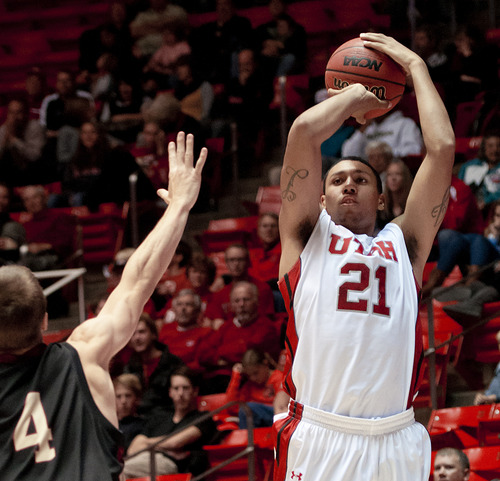 Michael Mangum  |  Special to the Tribune  Utah forward Jordan Loveridge (21) pulls up for a jumpshot during their game against the Willamette Bearcats at the Huntsman Center on Friday, November 9, 2012. Loveridge led the team with 18 points and the Utes beat the Bearcats 104-47.